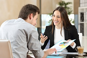 Insurance agent discussing employee benefits coverage