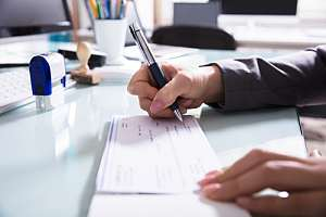 Employee paying workers compensation check