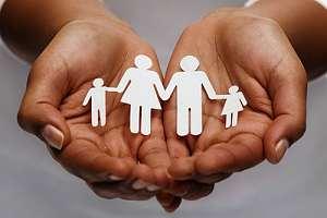 Hand holding family cutout - individual life insurance