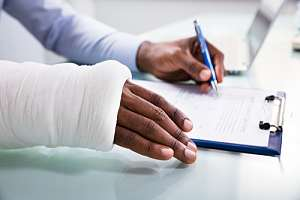 Injured employee filling out workers compensation paperwork