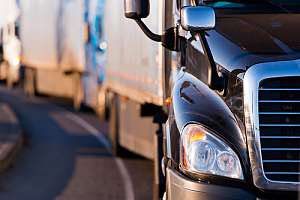 Row of trucks with trucking insurance
