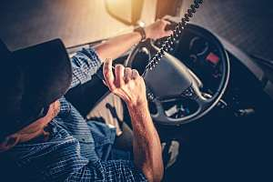 Trucker driving with trucking insurance