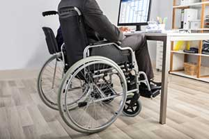 Employee in a wheelchair at his desk