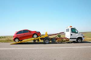 Car loaded onto tow truck