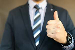 Directors and officers insurance agent giving thumbs up