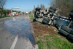 Overturned tow truck