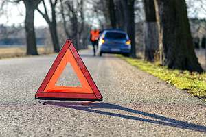 Warning triangle on road