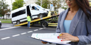 Woman with towing insurance filling out paperwork