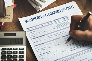 a small business owner applying for workers compensation insurance for his employees