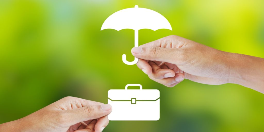 representational image of one hand holding an umbrella and another hand holding a bag as Business insurance protects business establishments