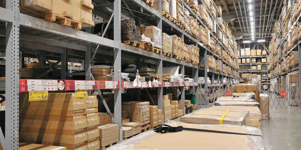Rows of products in a warehouse. Product recall insurance covers many types of incidents and losses