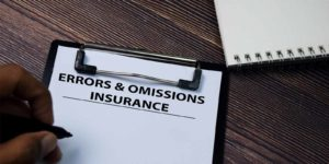Errors and omissions insurance paperwork on desk