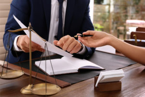 advisor tells client the legal ramifications of their business and why they need fiduciary liability insurance
