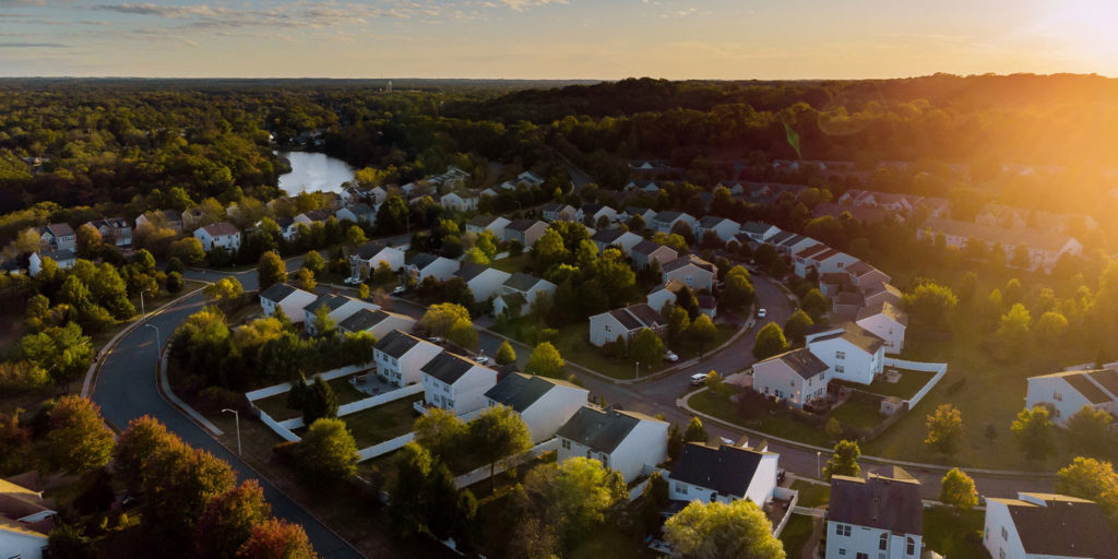 sunset overview of home that need HOA Insurance