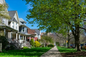Row of Old Wood Homes with Grass who have HOA Insurance