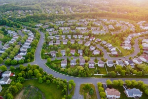 Top view aerial of residential homes that have HOA Insurance
