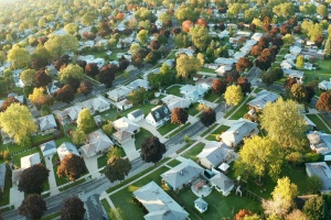 Aerial view of residential houses  that need hoa insurance