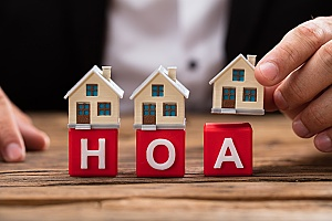 building blocks representing HOA insurance for homeowners