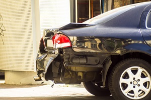 a car has a dented rear bumper after an accident