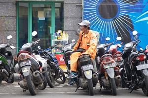 bike watcher working beside a street in banding