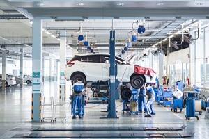 car technician repairing car in workshop service station