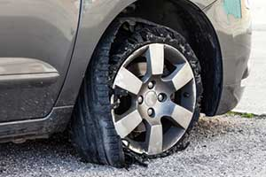 Blown out tire on car