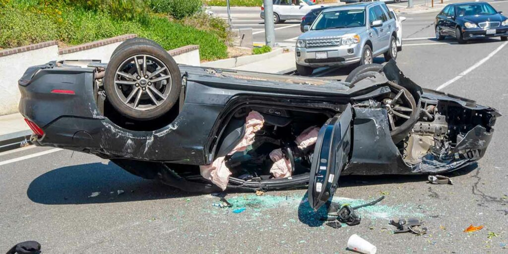 Car flipped over protected by physical damage insurance coverage