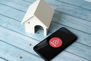concept landlord insurance for airbnb application icon on smartphone